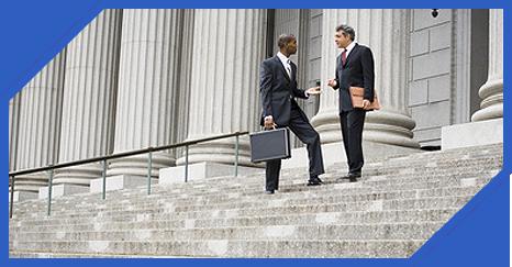 Business Men talking on steps